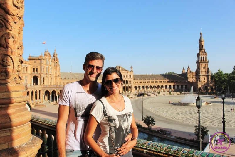 Couple in Seville posing for photo before flight.