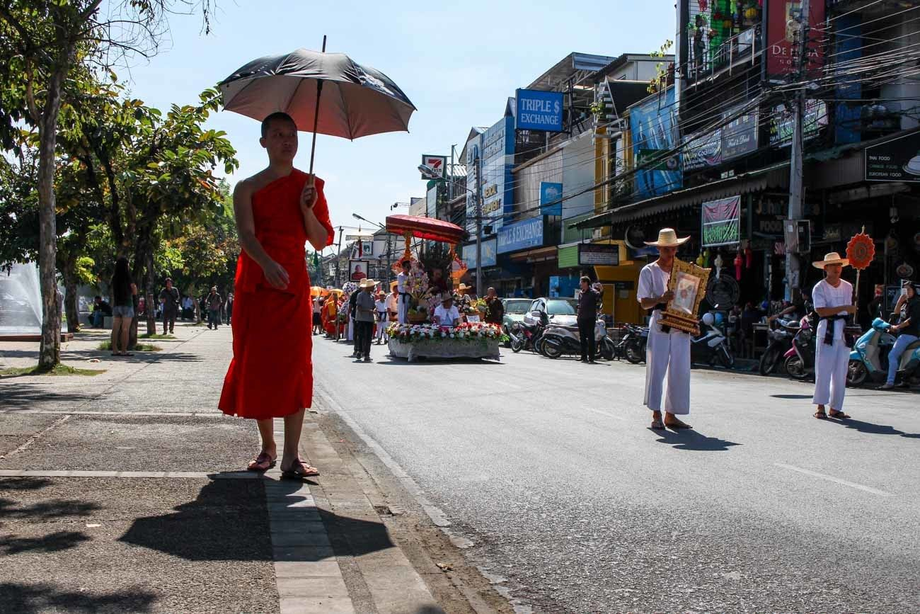 Monk walking in a street of Chiang Mai old town that has a very rich culture.