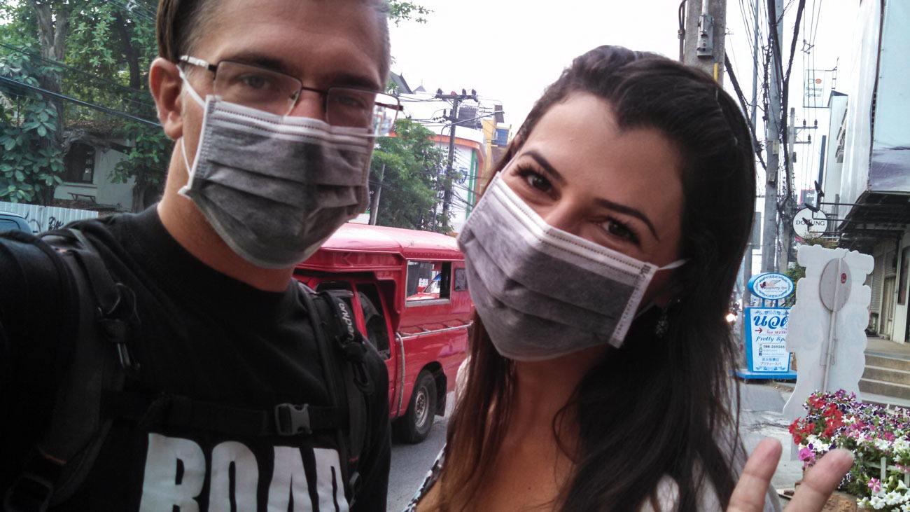 Couple on masks in Chiang Mai's burning season.