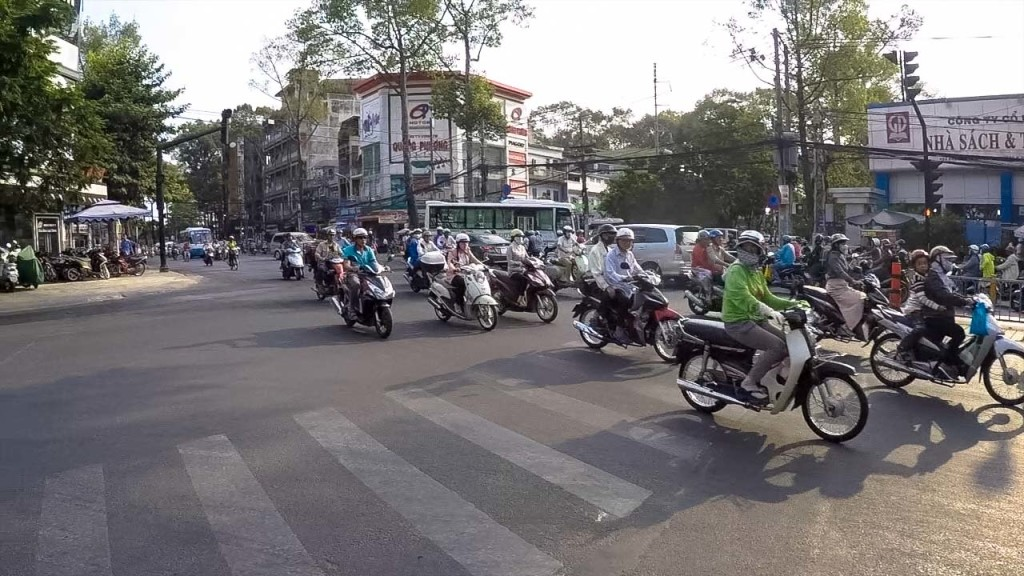Survive the crazy and busy traffic in Saigon - a daily challenge if you want to visit Ho Chi Minh City tourist spots on foot.