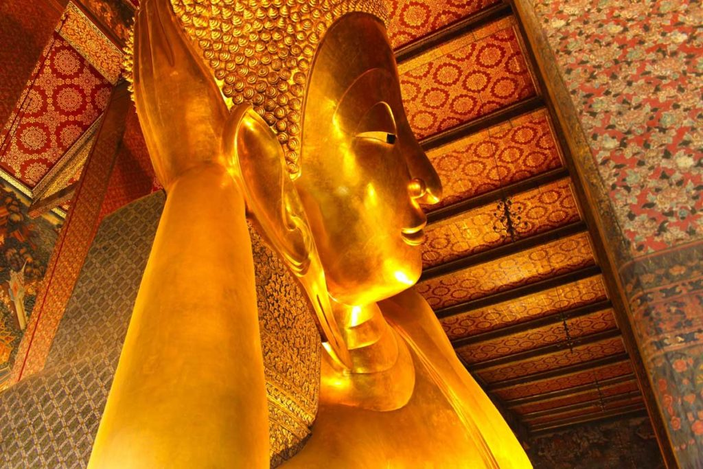 Travel tips for first time in Bangkok, visit the Wat Pho early in the morning.