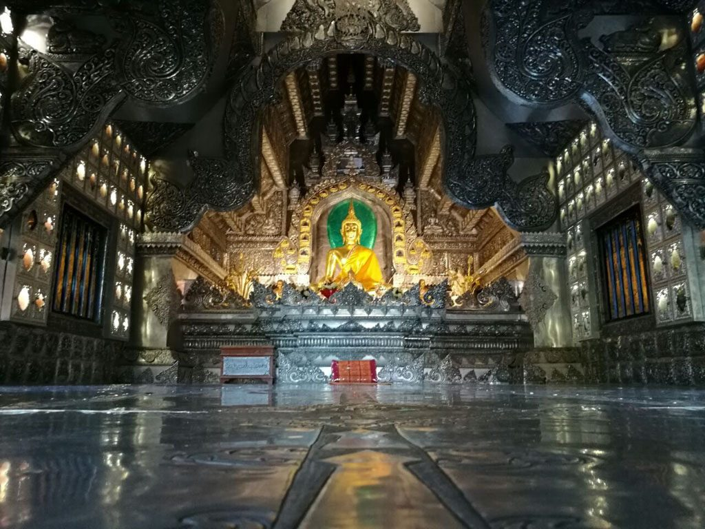 The interior of the Silver Temple justify it's presence on our what to do in Chiang Mai guide.