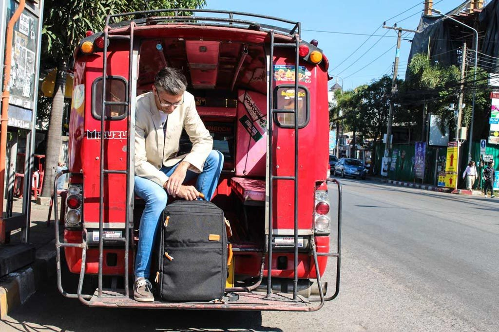 The red trucks are a popular among locals and tourists to get around Chiang Mai.