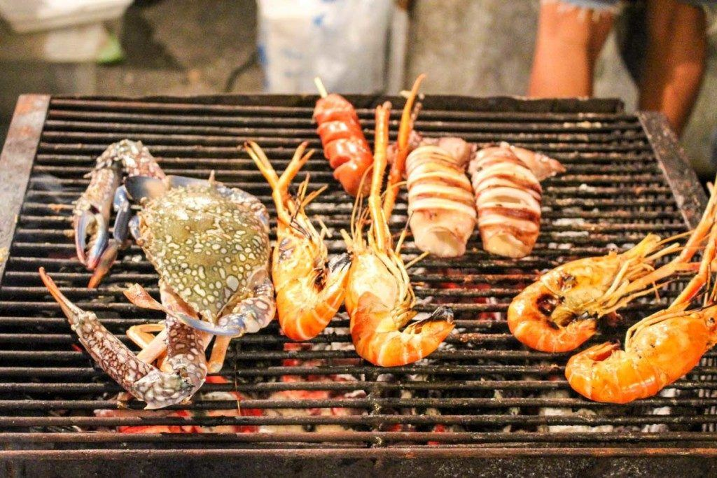Photo of seafood BBQ, a typical food at Thailand night markets.