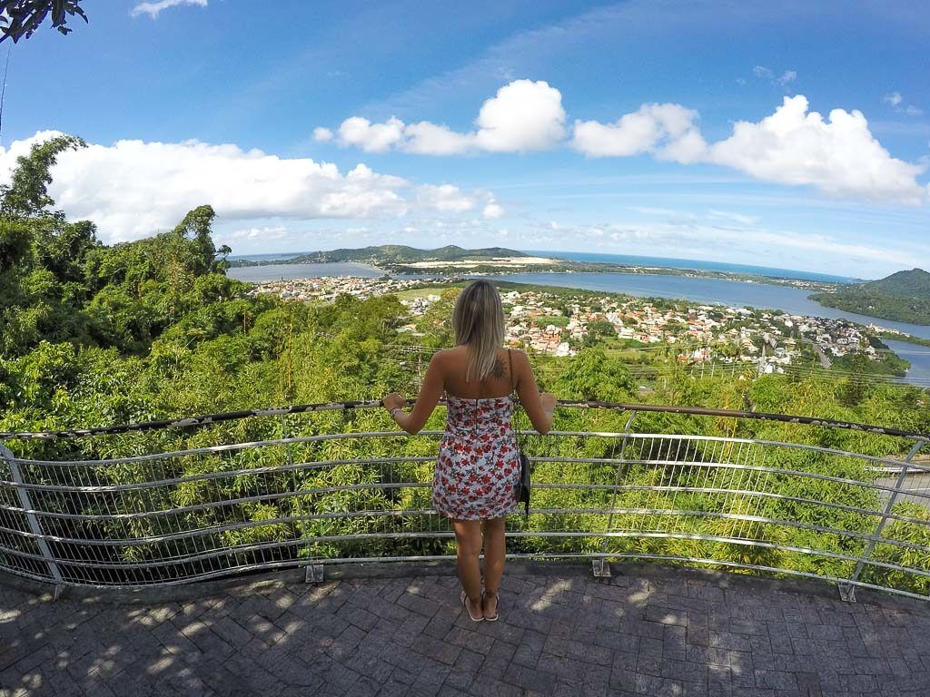 Woman in a viewpoint in Florianópolis, Brazil. You can see the Lagoa da Conceição at the back. It's one of the best places to stay in Florianópolis.