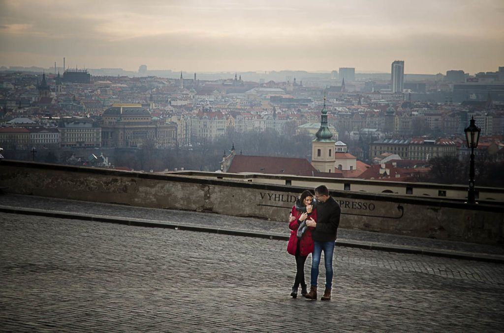 Couple being photographed in Prague Castle, showing Localgraph as a travel gift for couples.