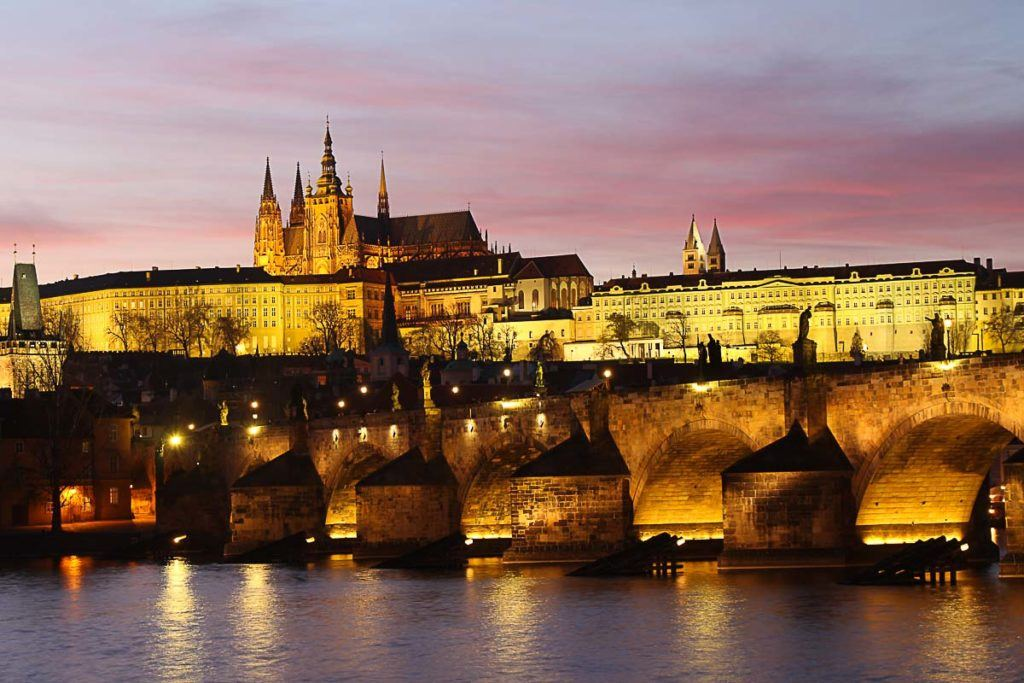 Charles Bridge and Prague Castle lighted up in the evening. Prague is known for its beautiful architecture and it's often included in many European travel itineraries.