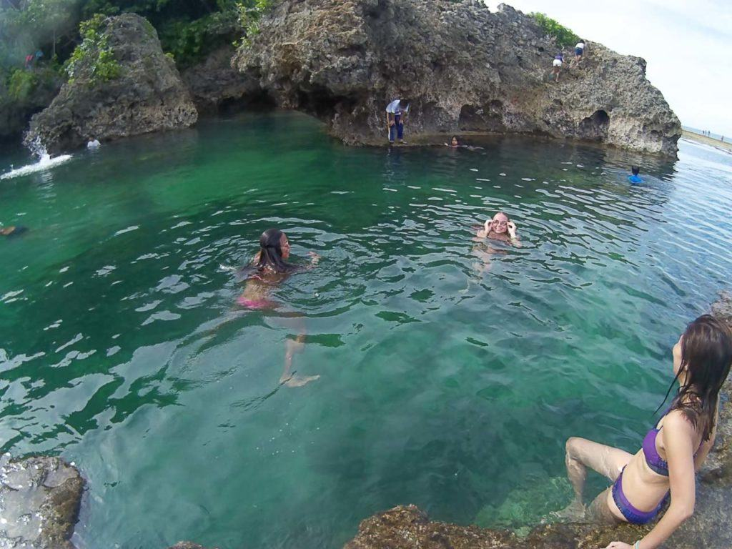 Top things to do in Siargao: island hopping tour, a visit to Magpupungko Pools and Sugba Lagoon.