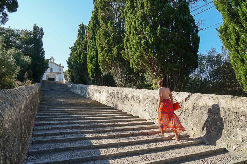 Woman walking over stairs in nearby village of bootcamp in Spain.