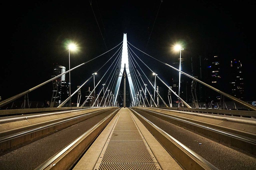 Visit Erasmus Bridge during day and night, this iconic bridge is stunning.