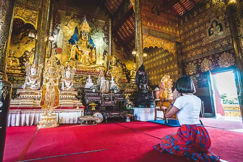 At the Wat Sang Kaew Phothiyan, our local guide explained how to pray and I was blessed by a monk.