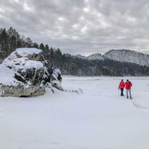 Walking over a frozen river in the Altai Mountains in Siberia, Russia