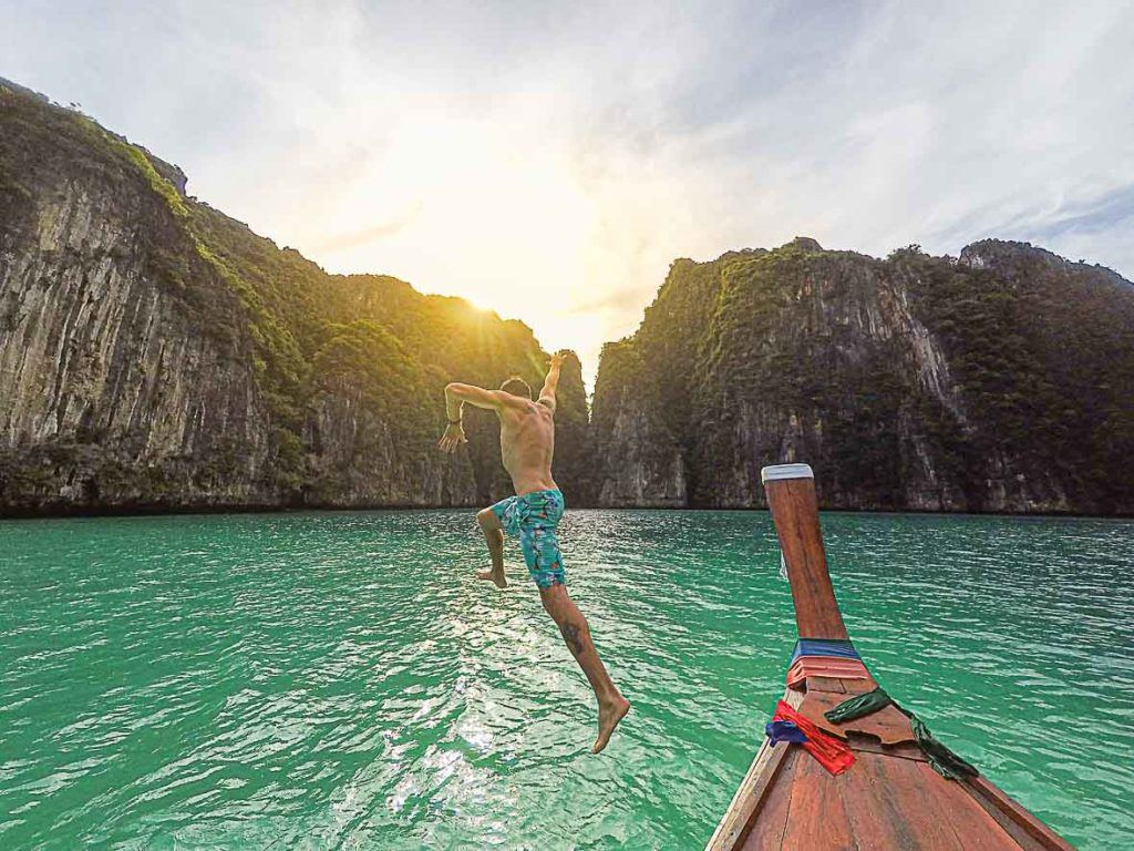 man about to jump in the sea of Phi Phi Island, Thailand