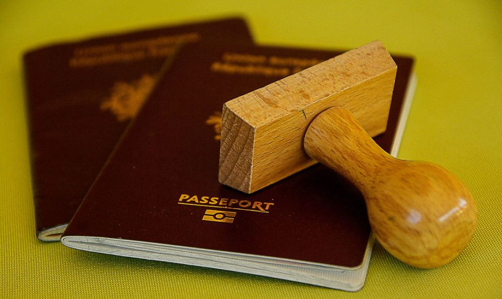 A stamp and two passports applying for an ESTA for US travel.