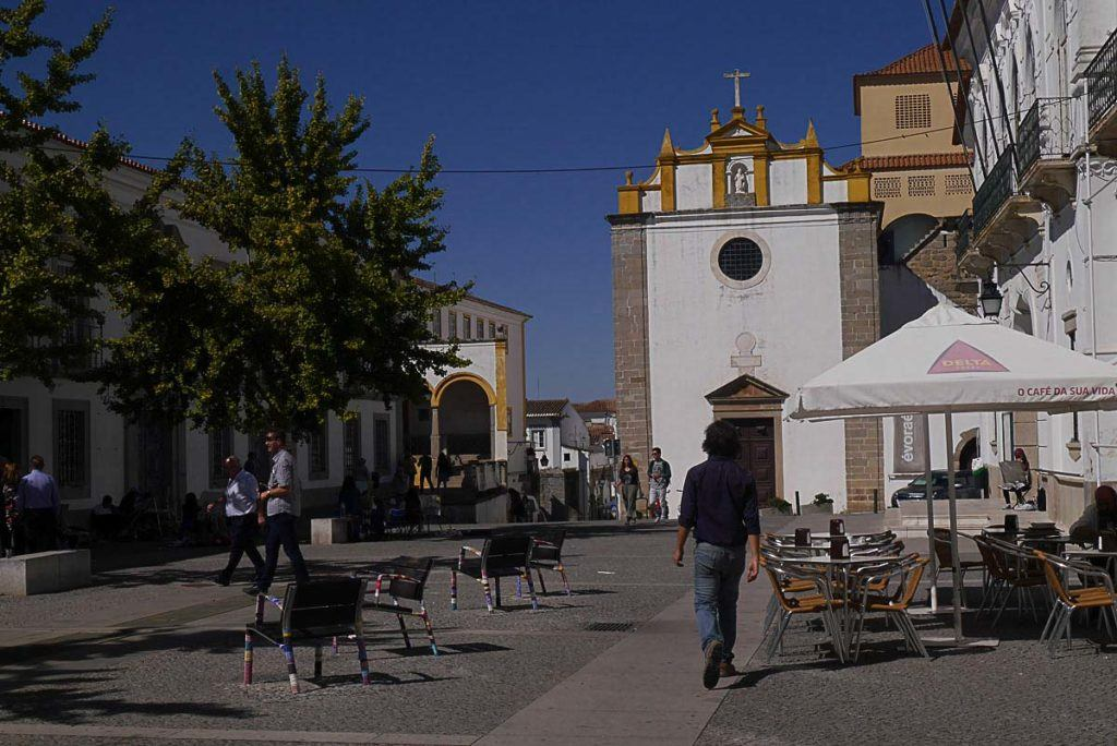 People walking and looking for things to do in Evora, Portugal.