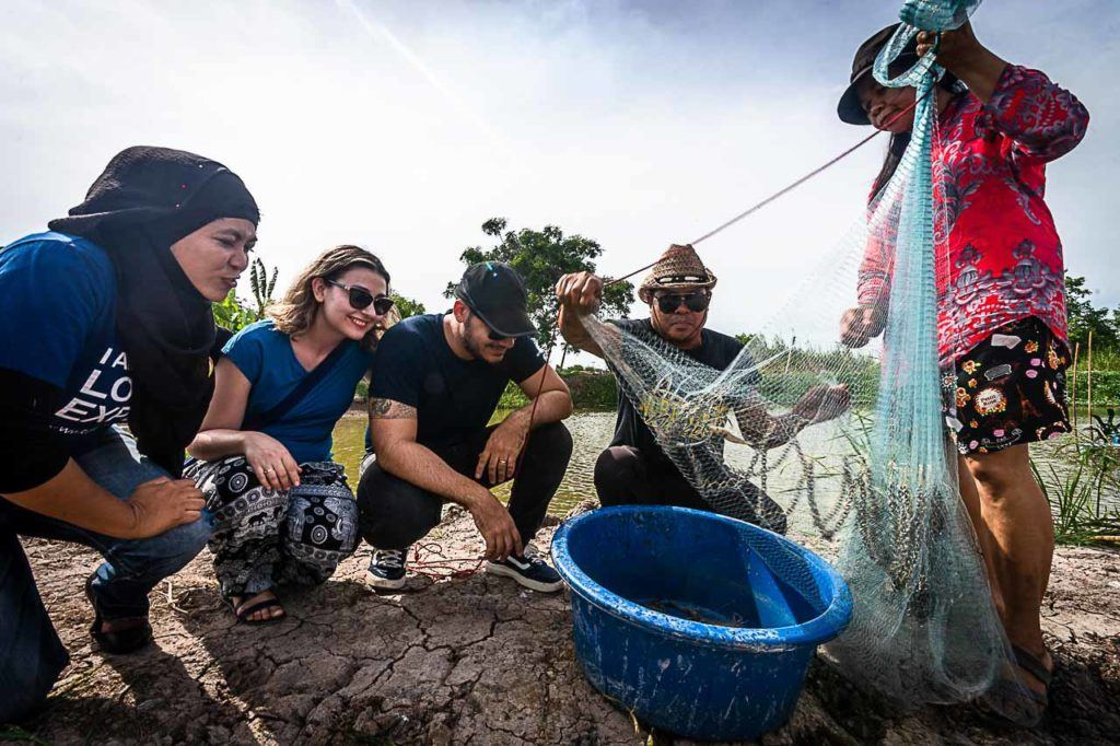 Travelers stopped at a shrimp farm during their Ayutthaya day trip.