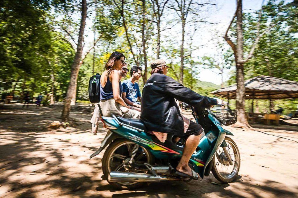 Tourists traveling on a tuk-tuk in Kanchanaburi National Park.