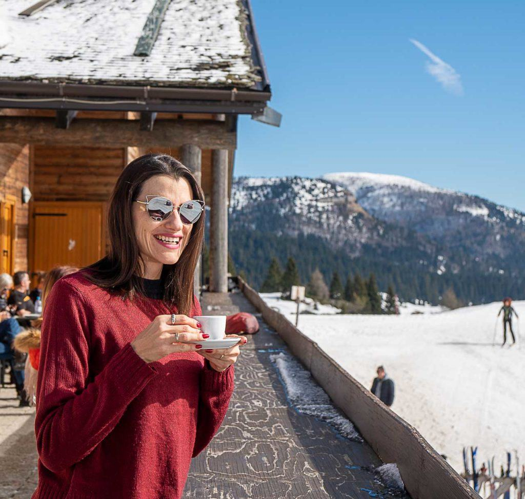 Woman drinking a coffee in a hotel in Folgaria, Alpe Cimbra - Italy