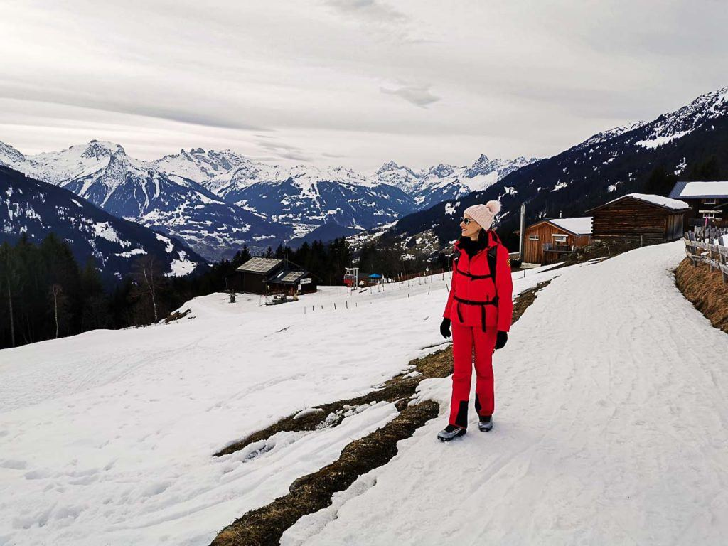 Woman on a snow hike in the winter at Montafon.