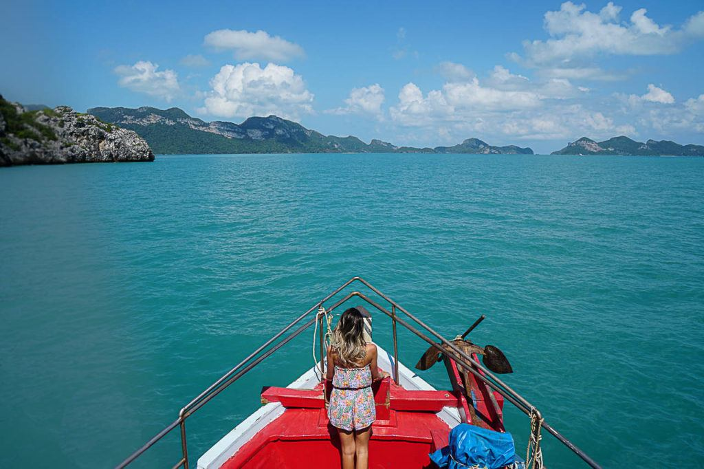 Woman standing in the boat's bow arriving to Koh Samui.