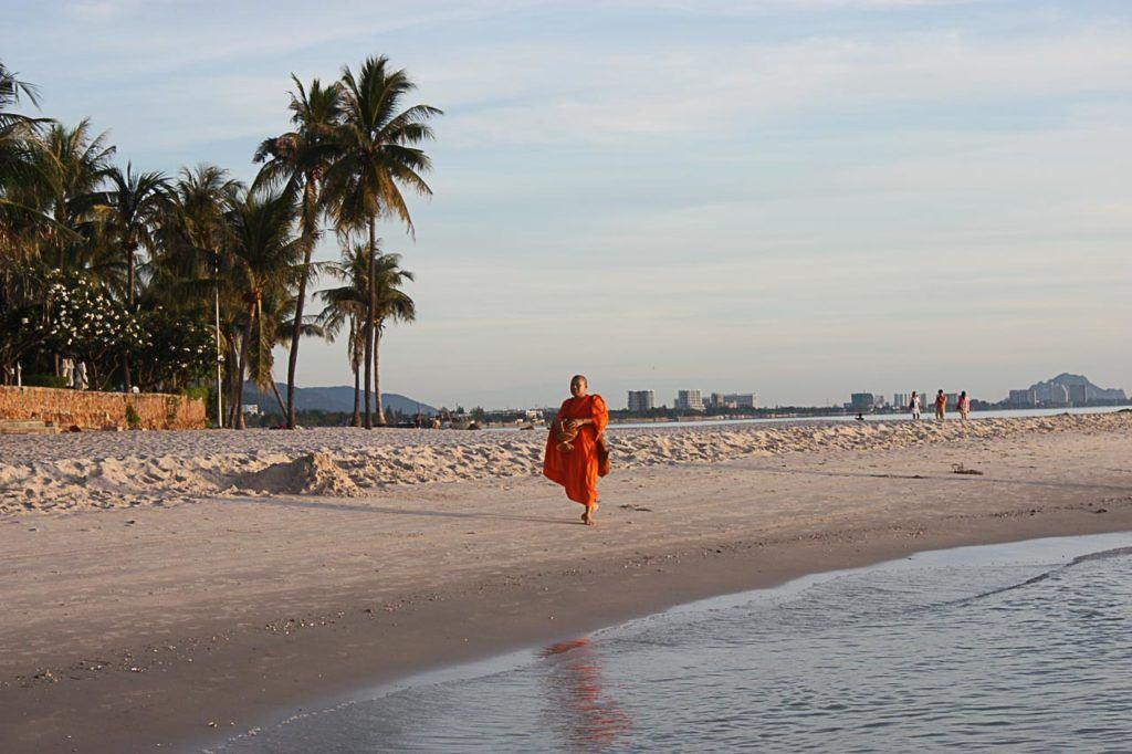 A monk walks on the beach in Hua Hin, Thailand.