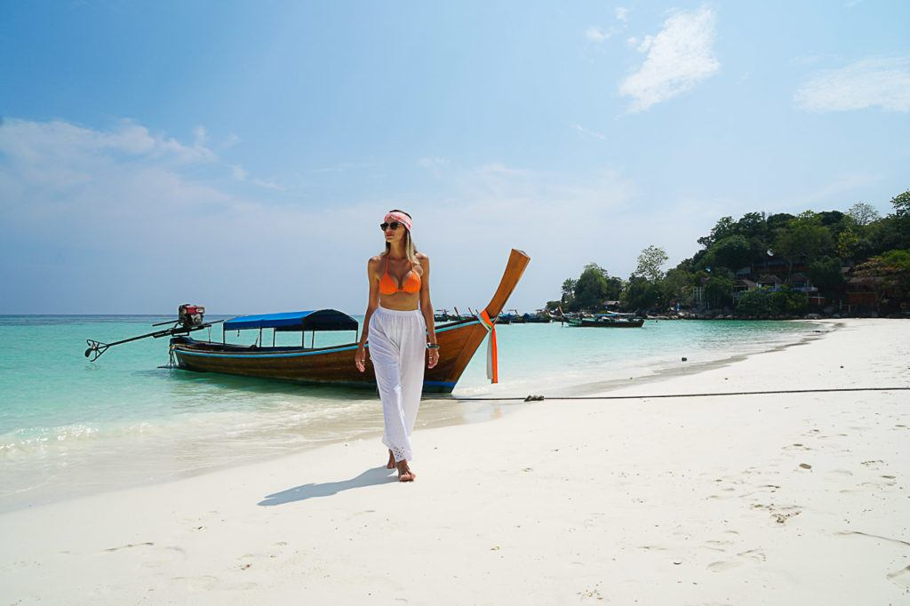 Woman walking on Pattaya Beach, Koh Lipe Island.