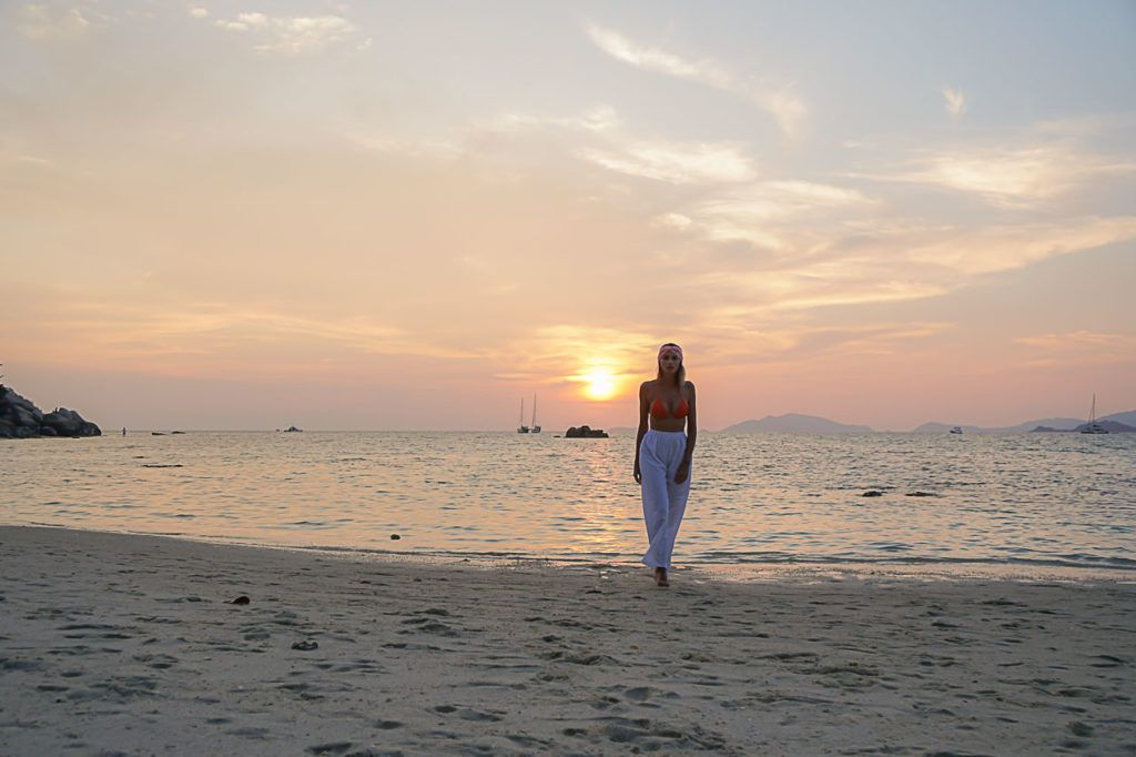 Woman on Sunset Beach, a small and hippie beach in Koh Lipe, Thailand.