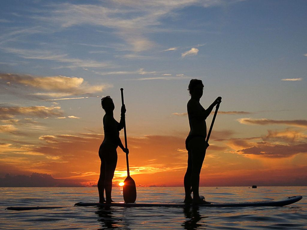 SUP is a great way to enjoy the sunset at Sairee Beach, Koh Tao.
