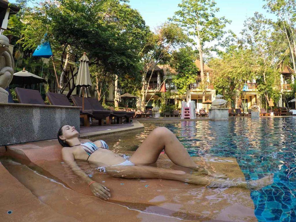 Woman sunbathing in the pool in at Crown Lanta Resort.