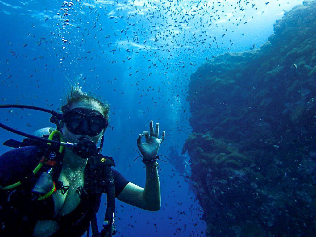 Woman scuba diving.
