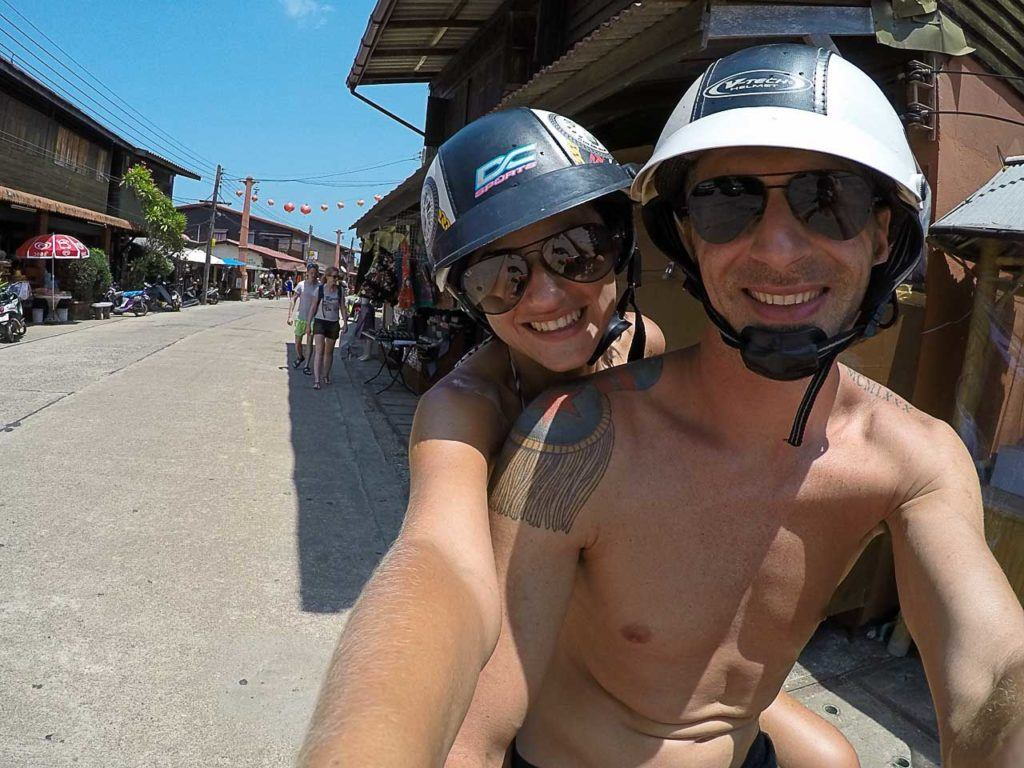 Couple exploring the island on a scooter and loves it.