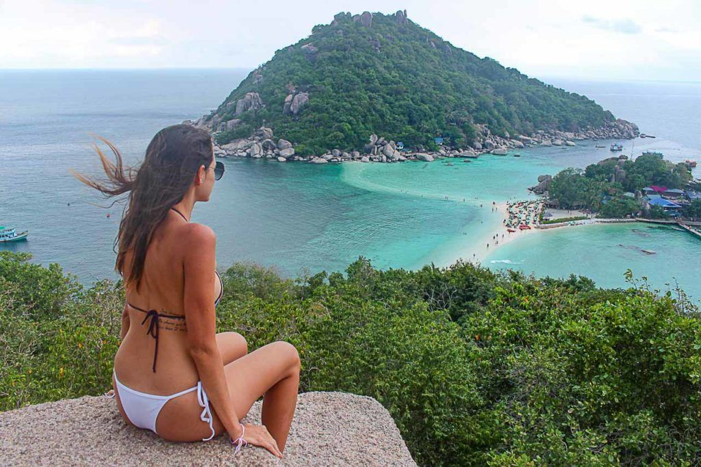 Traveler looking the island from a viewpoint.