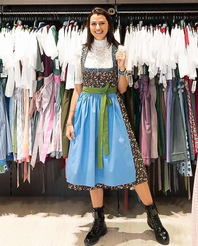Woman trying on a Dirndl (a traditional Austrian dress) at Weintracht Shop, in Graz.