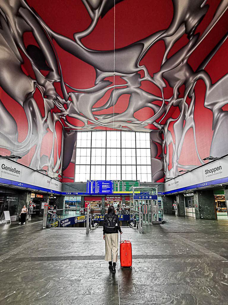 You can travel to Graz by train (Graz Hauptbahnhof is their train station).