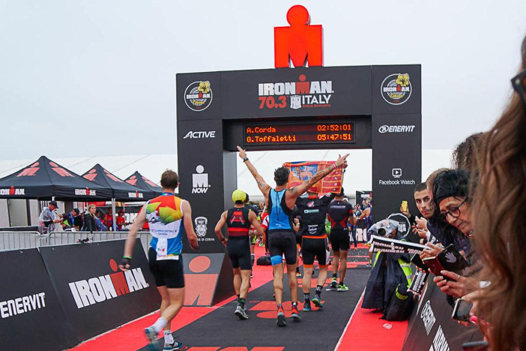 Contesters crossing the Ironman finish line. Find out here where to stay for Ironman Cervia.