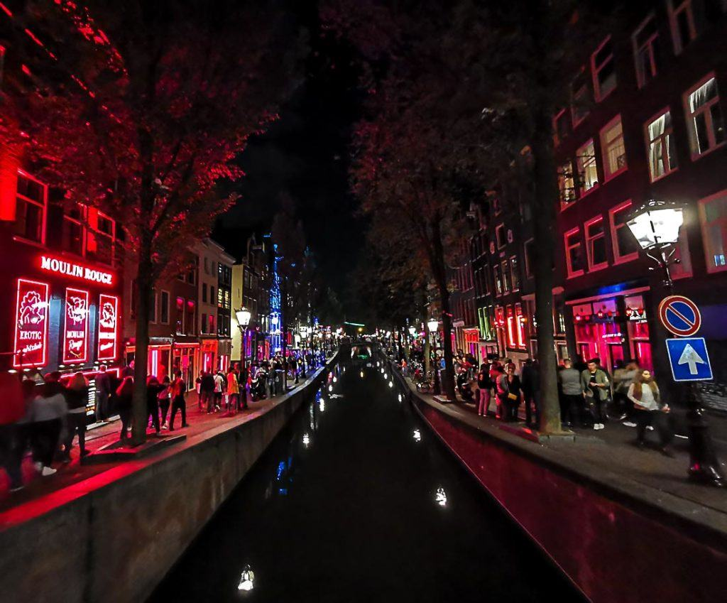 Night life shot on a street in Amsterdam. Check out this article if you are planning your budget for an Amsterdam Trip, we covered all its costs here.