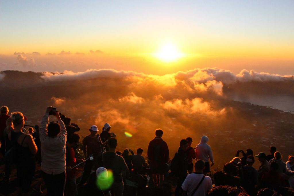 Sunrise from the top of Mount Batur. Discover all activities and tour prices in Bali while reading this travel budget article.