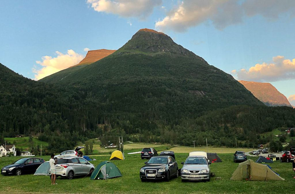 A Camp site in Norway with a mountain at the back. Read this post to learn all about costs of accommodation and hotel prices in Norway.
