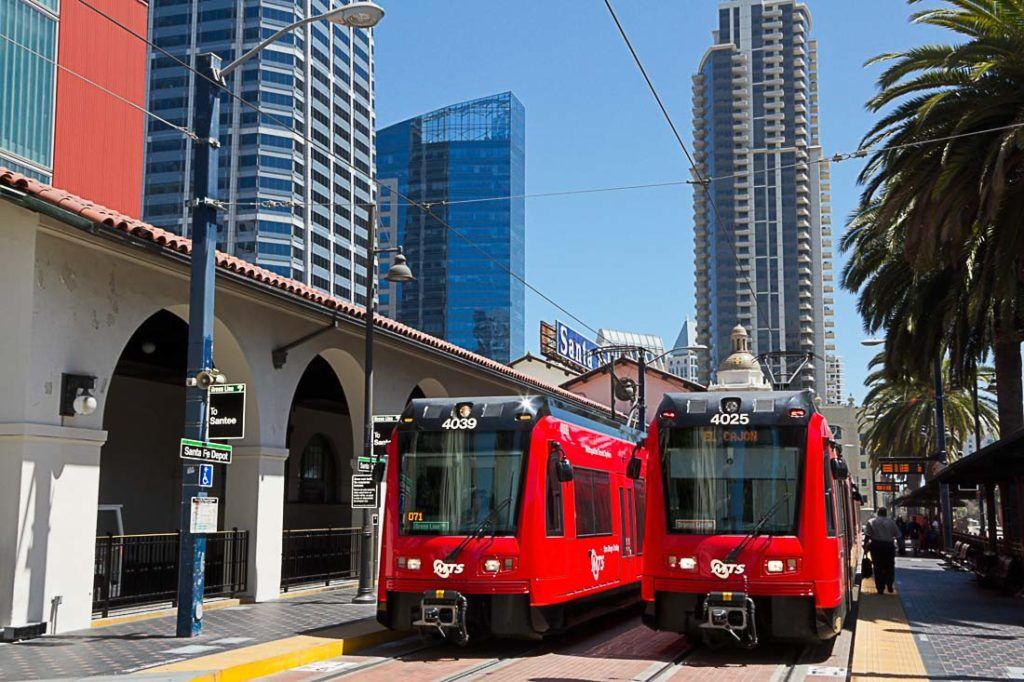 Two red trolleys at the station in San Diego, California, USA. Discover all the costs of traveling to San Diego, California in this complete travel budget article . Prices of food, transport, accommodation and more.