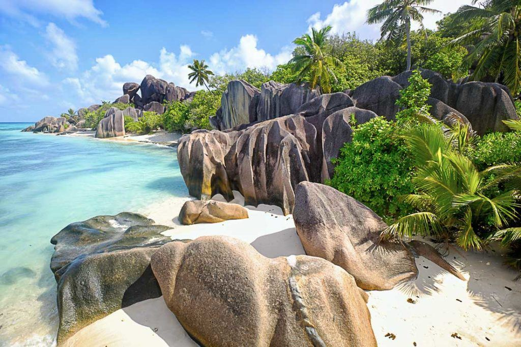 Anse Source d'Argent beach in La Digue Island, Seychelles. Discover all the costs of traveling to Seychelles in this complete travel budget article. Prices of food, transport, accommodation and more.