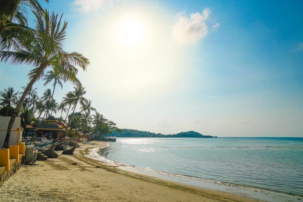 Chaweng Bech in Koh Samui, Thailand. Palm tree and calm sea make for one of the best beaches in Samui.
