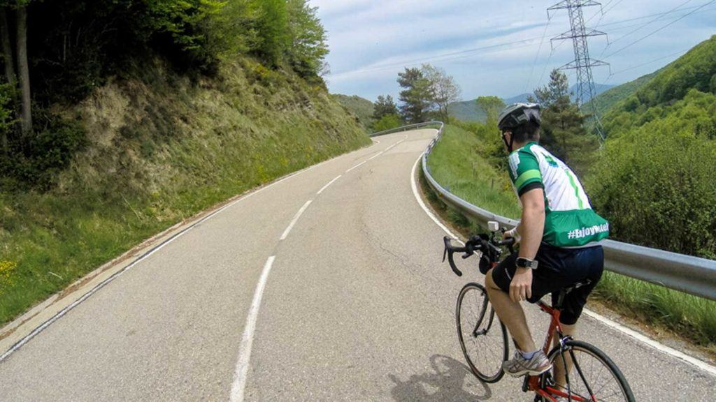 Man doing a cycling tour in Spain. Riding from the Pyrenees to Costa Brava, a famous cycling route.