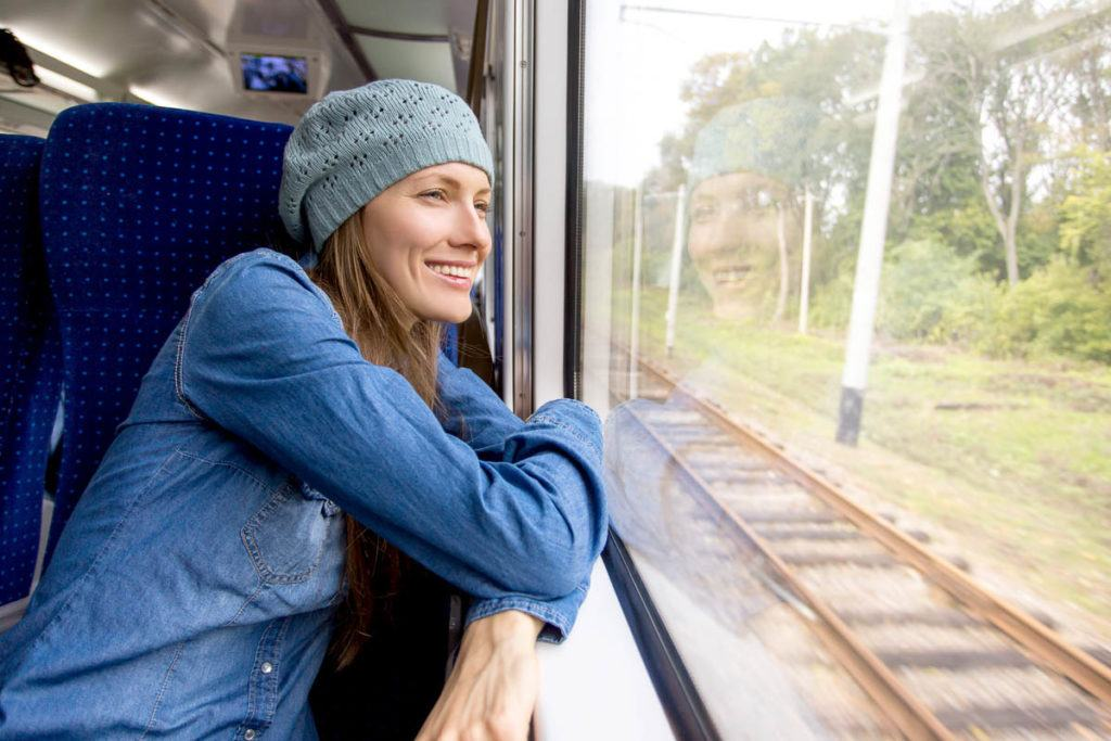 A woman that got an au pair job in Europe traveling by train.
