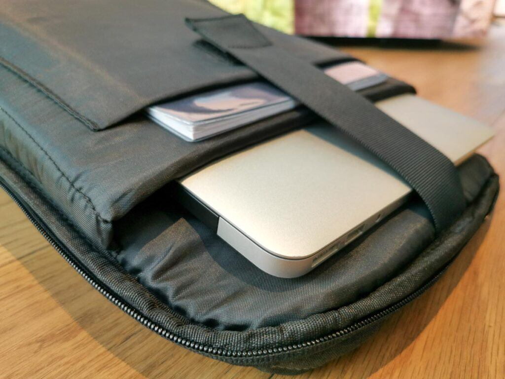 Photo of an open backpack showing the compartment for carrying the laptop. It's a carry-on backpack for laptops.